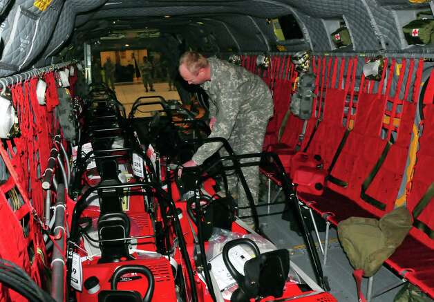 In this photo released by the New York National Guard, Staff Sgt. Jeff Lentz secures snowblowers inside a helicopter in Latham, N.Y., Thursday, Nov. 20, 2014, before transporting them to Buffalo.  (AP Photo/New York National Guard, Sgt. 1st Class Steven Petibone) Photo: Sgt. 1st Class Steven Petibone / New York National Guard