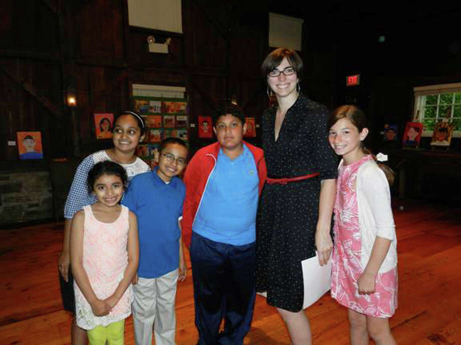 Greenwich Historical Society's Curator of Education, Anna Marie Greco, is joined by, from left, young local history buffs Marisol Flores, Anika Gupta, Carlos Flores, Glen Rivas, and Victoria Delaurentis. Photo: Contributed Photo / Greenwich Time Contributed