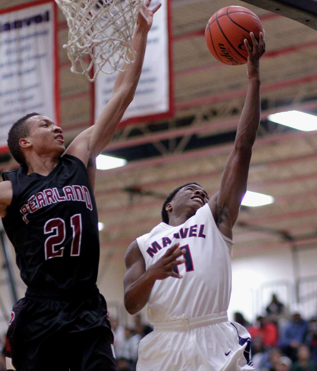 Manvel's D'Eriq King has his layup attempt blocked by Pearland' s Jeremy Sneed during a high school basketball game Tuesday, January 114, 2014. (Bob Levey/Special To The Chronicle)