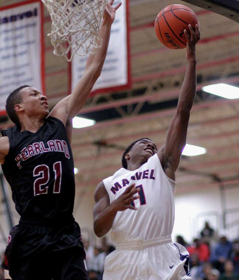 Manvel's D'Eriq King has his layup attempt blocked by Pearland' s Jeremy Sneed during a high school basketball game Tuesday, January 114, 2014. (Bob Levey/Special To The Chronicle) Photo: Bob Levey, Special To The Chronicle / ©2014 Bob Levey