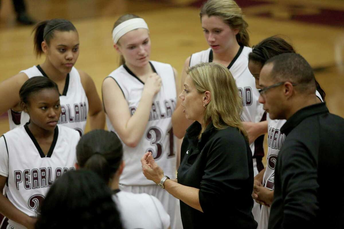 1/14/14: Pearland Oilers head coach Donna Vacek talk about strategy against the Manvel Mavericks in a high school basketball game at Pearland High School in Pearland, TX.