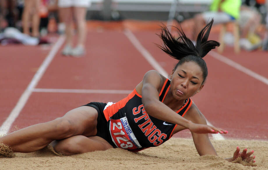 Texas City senior Asa Garcia won both the long jump and triple jump at the UIL State Track & Field Championships last spring atthe University of Texas, which will be her new home for the next four years starting next fall. Photo: Jerry Baker, Freelance