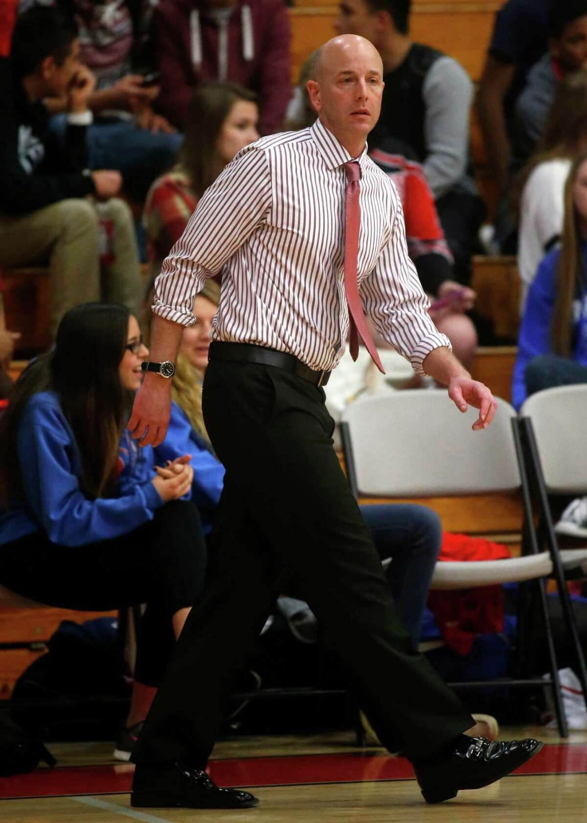 Clear Lake head coach Tommy Penders walks the side of the court during a high school basketball game against Clear Brook on Friday, Jan. 24, 2014, in Friendswood. ( J. Patric Schneider / For the Chronicle )