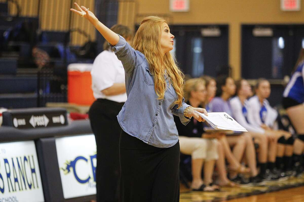 Cy Ranch head volleyball coach Arley Kocher gives instructions to her team as the Lady Mustangs took on Cy Creek at Cy Ranch High School in Cypress on September 19, 2014