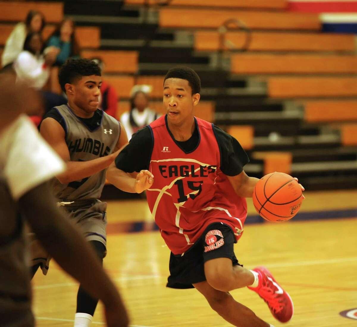 Atascocita's Alan Johnson (15) got around Humble's defense and drove to the basket to score last week.