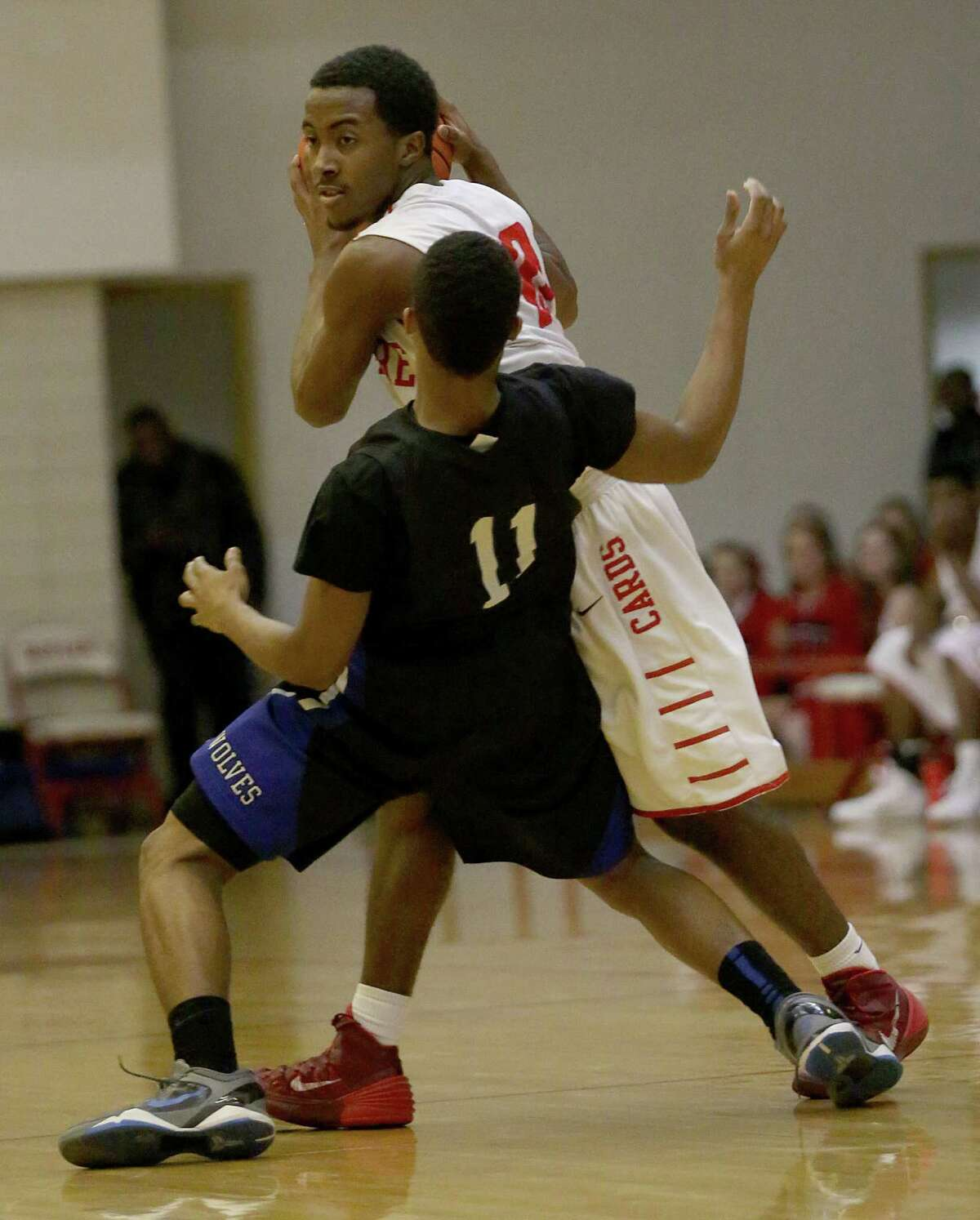 1/17/14: Bellaires' Jarren Greenwood (10) defends the ball from Westsides' Sherman Coleman (11) in a high school basketball game at Butler Field House in Houston, Texas. Westside won in overtime 55 to 50.