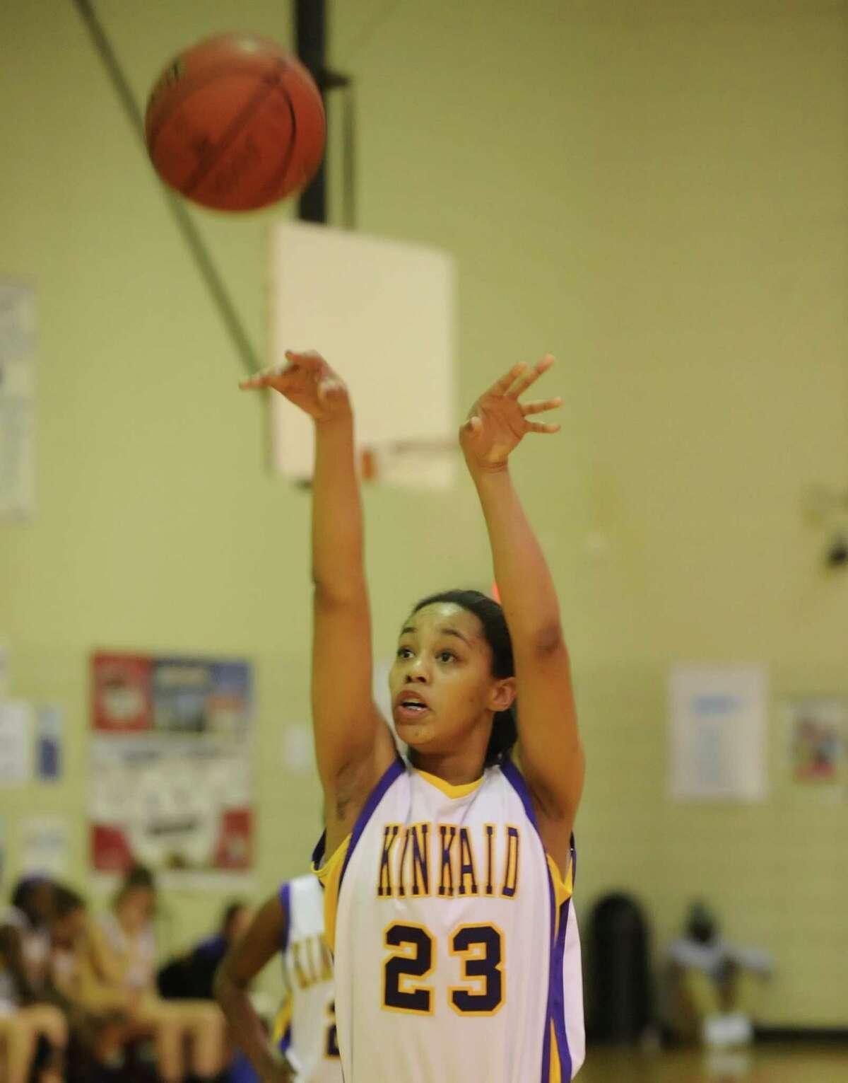 Kinkaid girls basketball team defeated Lamar's girls team, 81-47, at Lamar High School, 11-5-2013. Kinkaid's Alexis Johnson (23) scored on this free throw.