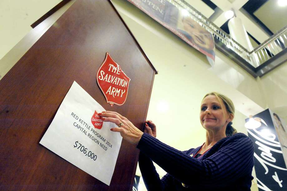 Kara Gilmore, donor relations assistant, sets up a podium for the Salvation Army's regional kettle campaign kick off at Crossgates Mall on Friday Nov. 21, 2014 in Guilderland, N.Y. (Michael P. Farrell/Times Union) Photo: Michael P. Farrell / 00029605A