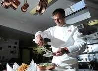Four Star Chef Thomas Henkelmann prepares his upscale take on the Thanksgiving Day classic dish, green bean casserole, at Homestead Inn, Greenwich, Conn., Friday, Nov. 21, 2014.