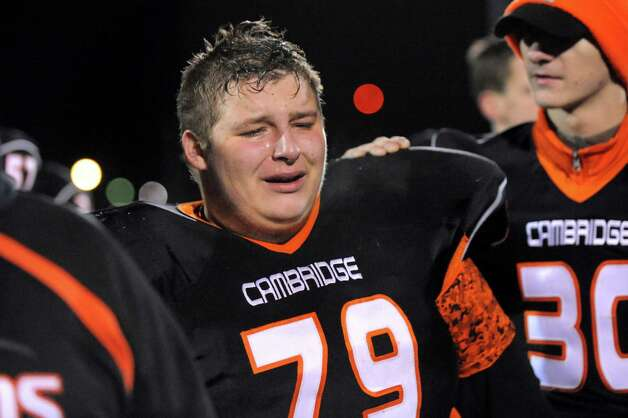 Cambridge's Keenan McCauley, center, reacts to his team's 47-14 loss to Chester in their Class D semifinal football matchup on Friday, Nov. 21, 2014, at Dietz Stadium in Kingston, N.Y. (Cindy Schultz / Times Union) Photo: Cindy Schultz / 00029565A