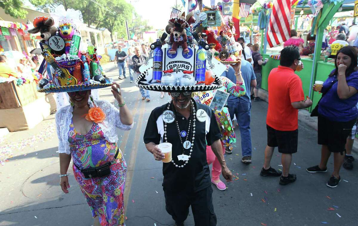Beyond NIOSA, La Villita, with proper guidance, can attract San Antonians and others year-round. Dora Gonzales (from left), Albert Limon, and Pauleen Gonzales stroll around La Villita with their finely adorned fiesta sombreros at the kickoff of 2014's Night In Old San Antonio.