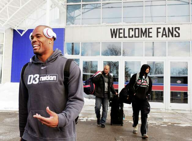 "Buffalo Bills running back Fred Jackson, left, leaves the field house with his teammates and prepares to board a bus Friday, Nov. 21, 2014, in Orchard Park, N.Y., as they gets set to travel to Detroit. Snowed out in Buffalo, the Bills are heading to Detroit to play their ""home"" NFL football game against the New York Jets on Monday night, Nov. 24, 2014. (AP Photo/Gary Wiepert) ORG XMIT: NYGW116 Photo: Gary Wiepert / FR170498 AP"