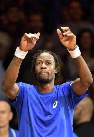 French tennis player Gael Monfils reacts after winning his match against Swiss tennis player Roger Federer, the second of the Davis Cup final, at the Stade Pierre Mauroy in Villeneuve-d'Ascq, northern France, on November 21, 2014. AFP PHOTO / PHILIPPE HUGUENPHILIPPE HUGUEN/AFP/Getty Images ORG XMIT: 887 Photo: PHILIPPE HUGUEN / AFP