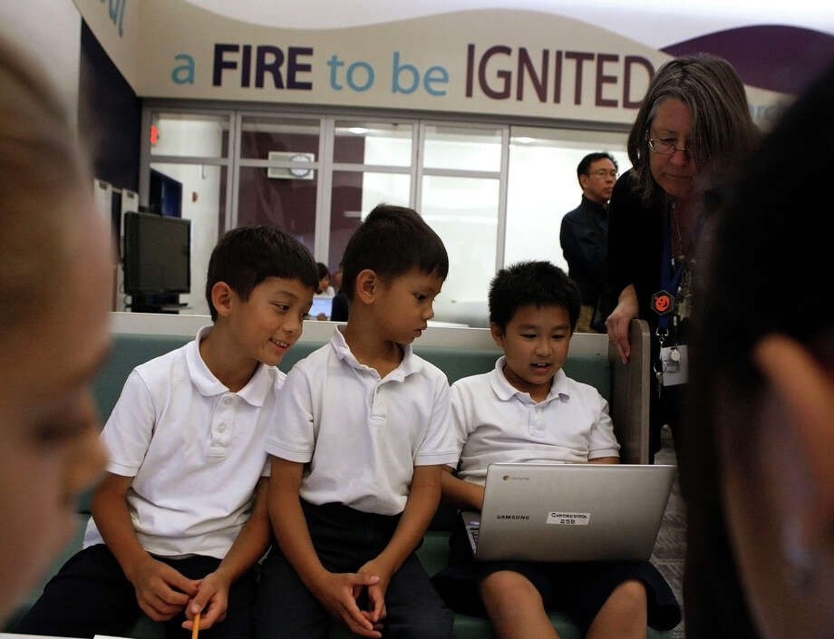 Third-graders Alex Lu (left), Richie Ngo and Ray Chuang use a Chromebook computer to research Indian tribes at Marshall Pomeroy Elementary School in Milpitas. Chromebooks are becoming more popular for use in schools. Photo: Liz Hafalia / The Chronicle / ONLINE_YES