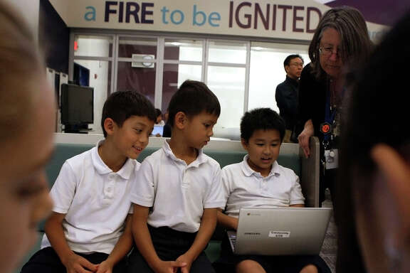 Third-graders Alex Lu (left), Richie Ngo and Ray Chuang use a Chromebook computer to research Indian tribes at Marshall Pomeroy Elementary School in Milpitas. Chromebooks are becoming more popular for use in schools.