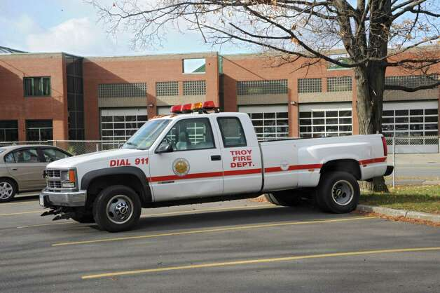 A Troy Fire Department pickup truck is parked in a lot in front on the Troy Fire Department on 6th Ave. Friday, Nov. 21, 2014 in Troy, N.Y.  Mayor Lou Rosamilia is expected to recommend several changes to his budget which may include changes to the police and fire departments. (Lori Van Buren / Times Union) Photo: Lori Van Buren / 00029591A