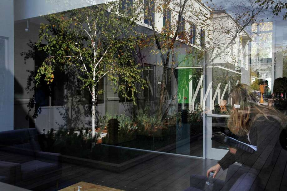 Reflections through the window of a building on the Facebook campus Nov. 12, 2014 in Menlo Park, Calif. Photo: Leah Millis / The Chronicle / ONLINE_YES