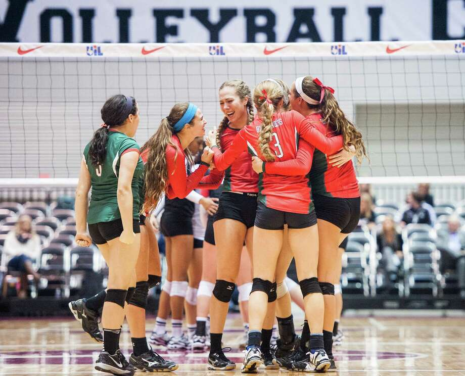 The Woodlands celebrates a point during their UIL Class 6A state semifinal volleyball match against Churchill on Fri., Nov. 21, 2014 at the Curtis Cullwell Center in Garland, TX. Ashley Landis/Special Contributor Photo: Ashley Landis / ***NOT FOR RESALE***