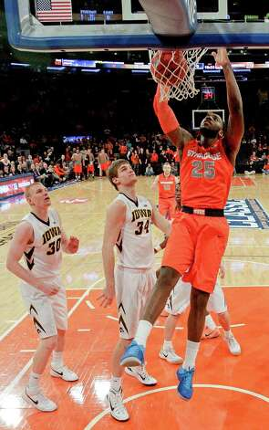 Syracuse's Rakeem Christmas (25) dunks the ball in front of Iowa's Aaron White (30) and Adam Woodbury (34) during the first half of an NCAA college basketball game at Madison Square Garden, Friday, Nov. 21, 2014, in New York. (AP Photo/Frank Franklin II) ORG XMIT: MSG108 Photo: Frank Franklin II / AP