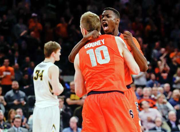 Syracuse's Kaleb Joseph embraces Trevor Cooney (10) as Iowa's Adam Woodbury (34) reacts during the second half of an NCAA college basketball game at Madison Square Garden, Friday, Nov. 21, 2014, in New York. Syracuse won 66-63. (AP Photo/Frank Franklin II) ORG XMIT: MSG112 Photo: Frank Franklin II / AP