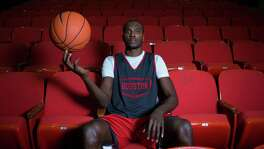 Devonta Pollard, a former McDonald's All-American, sits at The University of Houston, Wednesday, Nov. 19, 2014, in Houston.  Last year, Pollard had to testify against his own mother in a kidnapping case. (Cody Duty / Houston Chronicle)
