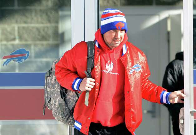 "Buffalo Bills quarterback Kyle Orton leaves the field house with his teammates and prepares to board a bus Friday, Nov. 21, 2014, in Orchard Park, N.Y., as they gets set to travel to Detroit. Snowed out in Buffalo, the Bills are heading to Detroit to play their ""home"" NFL football game against the New York Jets on Monday night, Nov. 24, 2014. (AP Photo/Gary Wiepert) ORG XMIT: NYGW113 Photo: Gary Wiepert / FR170498 AP"