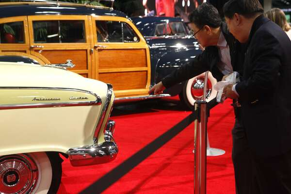 Young Kim, left, points out a detail to Hagen Choi about the 1956 Nash Ambassador at the SF Auto Show in the Moscone Center in San Francisco, Calif., on Friday November 21, 2014.