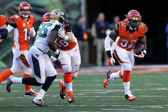Texans running back Alfred Blue, left, and Bengals running back Jeremy Hill will face each other for the first time as professionals Sunday at NRG Stadium. Teammates at LSU, the rookies maintain a friendly rivalry.