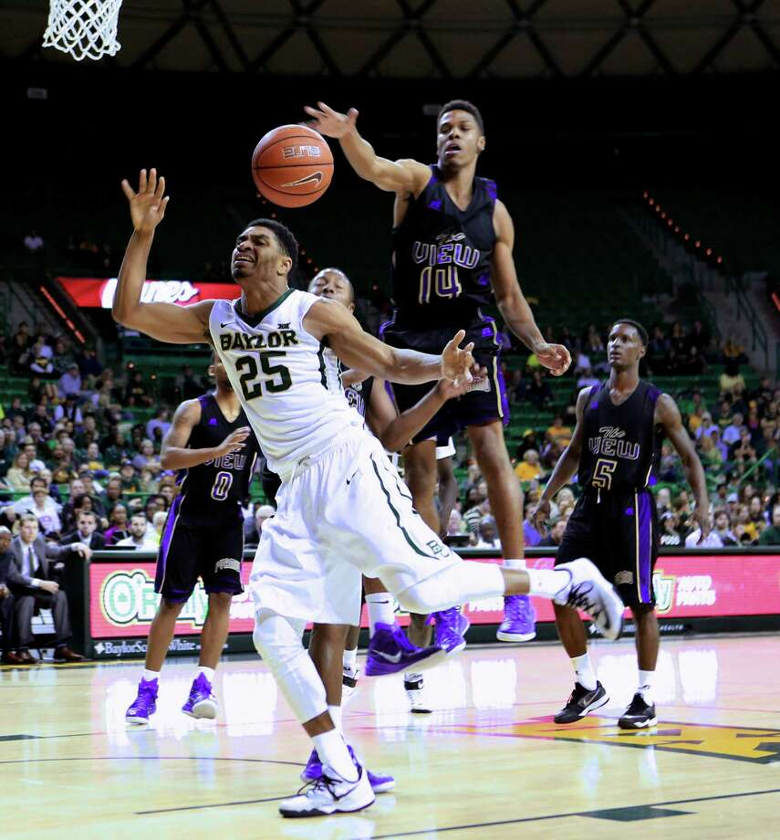 Baylor's Al Freeman (25) tries to get control of the basketball against Prairie View's Zachary Hamilton (14) during the second half of an NCAA college basketball game Friday, Nov. 21, 2014, in Waco, Texas. (AP Photo/Waco Tribune-Herald, Jose Yau) Photo: Jose Yau, Associated Press / Waco Tribune-Herald