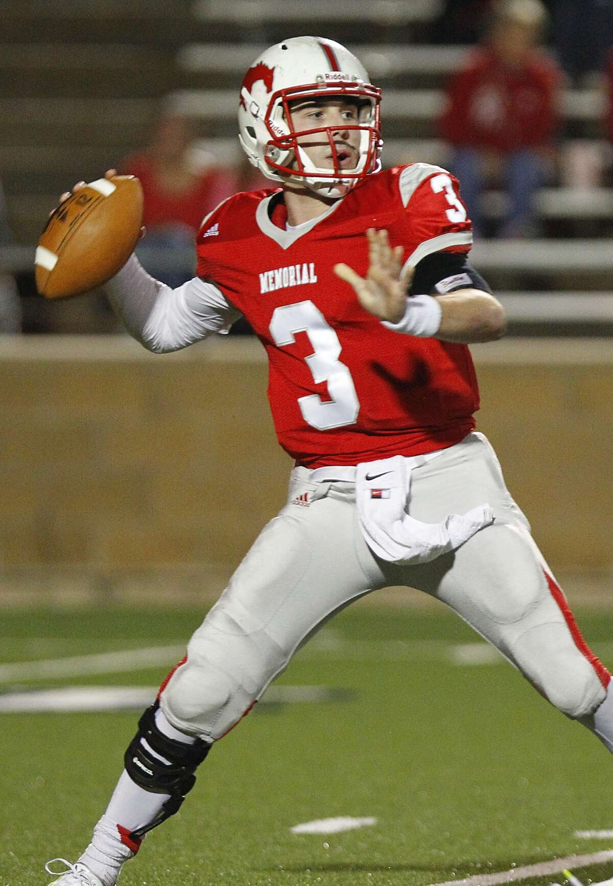 Houston Memorial quarterback Matthew Jordan looks for an open receiver as the Mustangs hosted the Katy Tigers in the 6A Region III Playoffs at Tully Stadium on November 21, 2014.