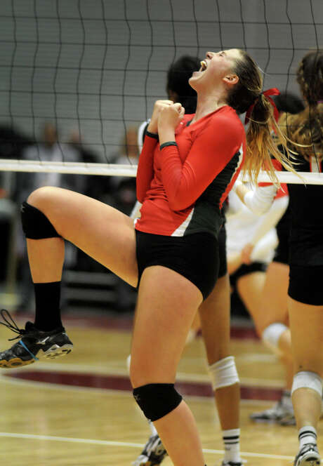 The Woodlands senior Rachel Reed savors the moment after her match-winning kill against San Antonio Churchill on Friday night. Photo: Jerry Baker, Freelance