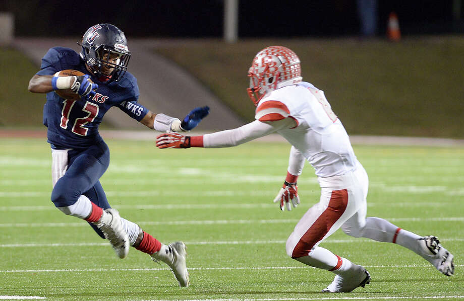 Hardin-Jefferson vs. La Grange1 p.m. Friday, Woodforest Bank Stadium, Shanandoah. Hardin-Jefferson's Deshon Moreaux looks to fend off the Bellville defender as he runs the ball during their play-off game Friday night in Aldine.