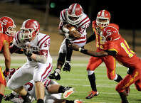 Jasper Bulldog Quentin Williams, 12, goes to the air during the match against the Stafford Spartans at the Carroll Thomas Stadium in Beaumont, Tx November 21, 2014. Photo by Drew Loker