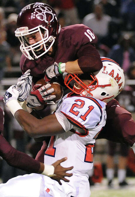 Cy-Fair's Maxx Chrest (18) intercepts a pass intended for Lamar's Ronnie Wesley. The Bobcats will play Dickinson on Nov. 29 at Rice Stadium. Photo: Eric Christian Smith, Freelance / 2014 Eric Christian Smith