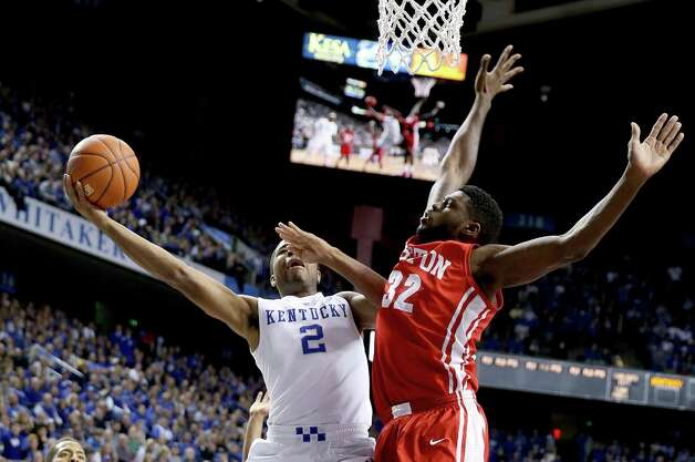 LEXINGTON, KY - NOVEMBER 21:  Aaron Harrison #2 of the Kentucky Wildcats shoots the ball during the game against the Boston Terriers at Rupp Arena on November 21, 2014 in Lexington, Kentucky.  (Photo by Andy Lyons/Getty Images) ORG XMIT: 519880381 Photo: Andy Lyons / 2014 Getty Images