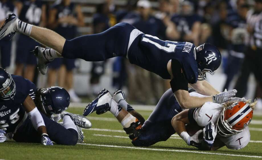 Rice Owls defensive end Brian Nordstrom (47) dives onto UTEP Miners tight end Eric Tomlinson (87) during the first half of a college NCAA football game at Rice Stadium, Friday, Nov. 21, 2014, in Houston.  ( Karen Warren / Houston Chronicle  ) Photo: Karen Warren, Houston Chronicle