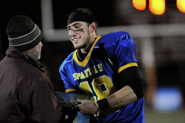 Queensbury's Jeffrey Underhill accepts the plaque for best defensive player following their 28-21 win over Cornwall in their Class A football state semifinal on Friday, Nov. 21, 2014, at Dietz Stadium in Kingston, N.Y. (Cindy Schultz / Times Union) Photo: Cindy Schultz / 00029566A