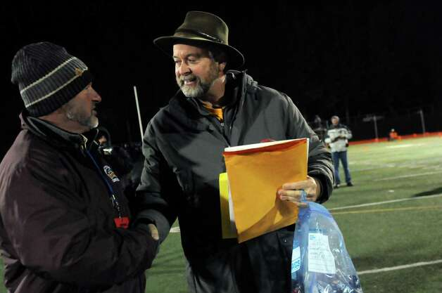 Queensbury's coach John Irion, center, gets passes to the state finals in Syracuse following their 28-21 win over Cornwall in their Class A football state semifinal on Friday, Nov. 21, 2014, at Dietz Stadium in Kingston, N.Y. (Cindy Schultz / Times Union) Photo: Cindy Schultz / 00029566A
