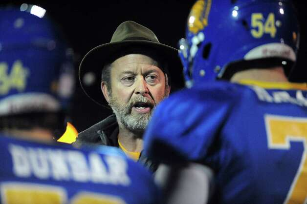 Queensbury's coach John Irion, center, instructs his players on the sidelines during their Class A football state semifinal against Cornwall on Friday, Nov. 21, 2014, at Dietz Stadium in Kingston, N.Y. (Cindy Schultz / Times Union) Photo: Cindy Schultz / 00029566A