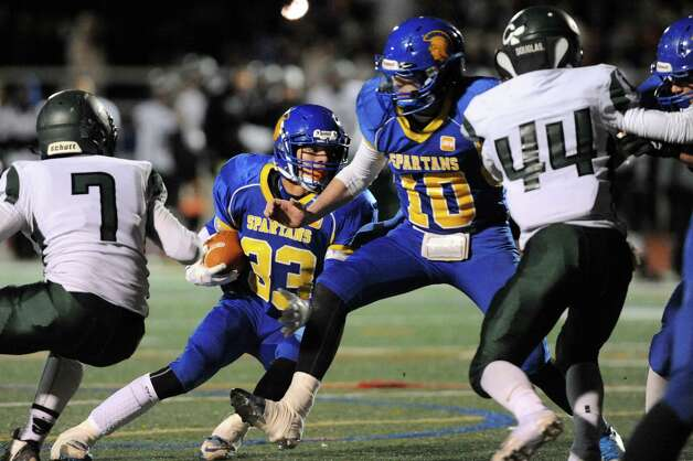 Queensbury's Brett Rodriguez (33) carries the ball as quarterback Drew Wilson (10) blocks during their Class A football state semifinal against Cornwall on Friday, Nov. 21, 2014, at Dietz Stadium in Kingston, N.Y. (Cindy Schultz / Times Union) Photo: Cindy Schultz / 00029566A