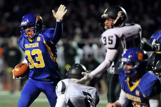 Queensbury's Brett Rodriguez, left, signals a touchdown during their Class A football state semifinal against Cornwall on Friday, Nov. 21, 2014, at Dietz Stadium in Kingston, N.Y. (Cindy Schultz / Times Union) Photo: Cindy Schultz / 00029566A