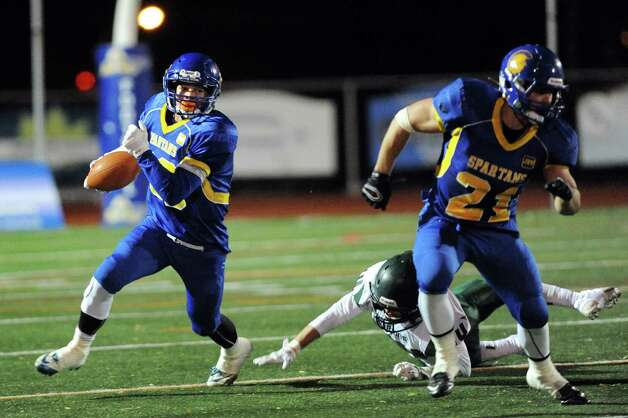 Queensbury's Brett Rodriguez, left, skirts a tackle as teammate Christopher Goudy helps block during their Class A football state semifinal against Cornwall on Friday, Nov. 21, 2014, at Dietz Stadium in Kingston, N.Y. (Cindy Schultz / Times Union) Photo: Cindy Schultz / 00029566A