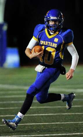 Queensbury's quarterback Drew Wilson  carries the ball during their Class A football state semifinal against Cornwall on Friday, Nov. 21, 2014, at Dietz Stadium in Kingston, N.Y. (Cindy Schultz / Times Union) Photo: Cindy Schultz / 00029566A