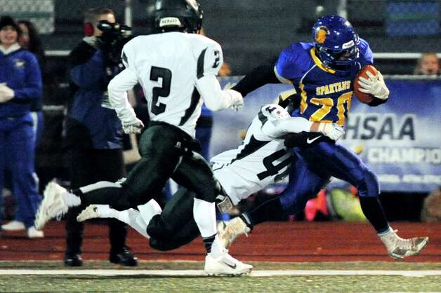 Queensbury's Tyrell Adams, right, drags Cornwall defender John Roth down the sideline during their Class A football state semifinal on Friday, Nov. 21, 2014, at Dietz Stadium in Kingston, N.Y. (Cindy Schultz / Times Union) Photo: Cindy Schultz / 00029566A