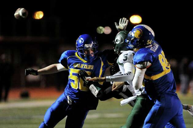 Queensbury's defensemen Benjamin Willows, left, and Keeghan O'Leary, right, pressure Cornwall quarterback Jason Bailey during their Class A football state semifinal on Friday, Nov. 21, 2014, at Dietz Stadium in Kingston, N.Y. (Cindy Schultz / Times Union) Photo: Cindy Schultz / 00029566A
