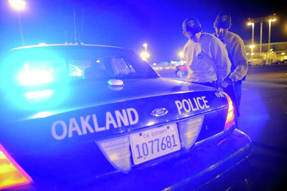 Cadet Raymond Morales, left, is cuffed and searched by cadet Giovanni Loverde during an exercise simulating a traffic stop and arrest as they participate in the Oakland Police Department Academy's night training exercises, held in the parking lot of the Oakland Coliseum in Oakland, CA, on Monday, October 26, 2014.