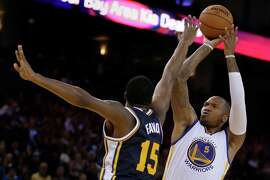 Golden State Warriors' Marreese Speights shoots against Utah Jazz forward Derrick Favors during the second half of an NBA basketball game Friday, Nov. 21, 2014, in Oakland, Calif. (AP Photo/Ben Margot)