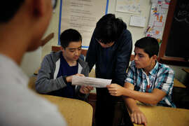 Benjamin Marquarat, 14; Theodore Dong, 14 and Franco Ramirez, 14, work together on a classroom exercise brainstorming a topic and research questions during Ethnic Studies class at Washington High School on Wednesday, November 12, 2014 in San Francisco, Calif.