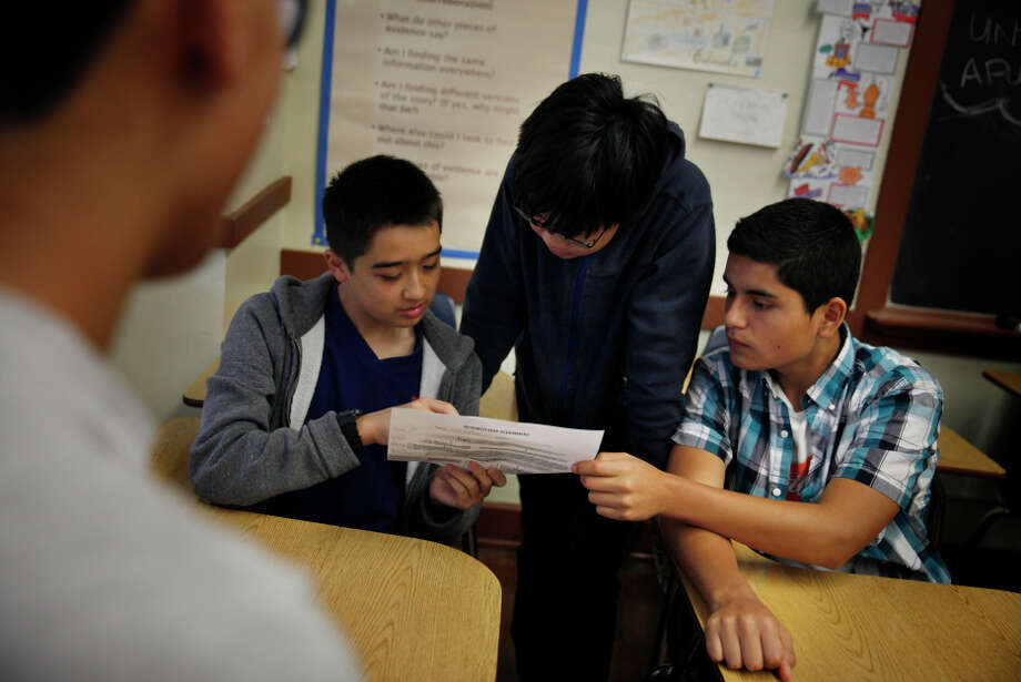 Benjamin Marquarat,  Theodore Dong  and Franco Ramirez, all 14, work on a classroom exercise, brainstorm ing a topic and re search questions during ethnic studies at Washington High. Photo: Lea Suzuki / The Chronicle / ONLINE_YES