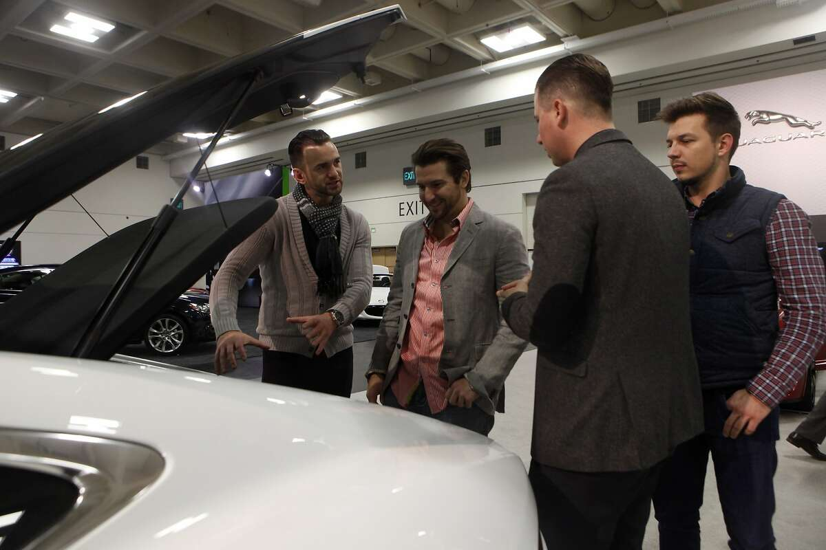 Gabriel Tudor, (front left to right), Don Crawford, Stefan Orsic and Vitaly Ivanchenko check out the trunk of a Jaguar F-Type at the SF Auto Show in the Moscone Center in San Francisco, Calif., on Friday November 21, 2014.